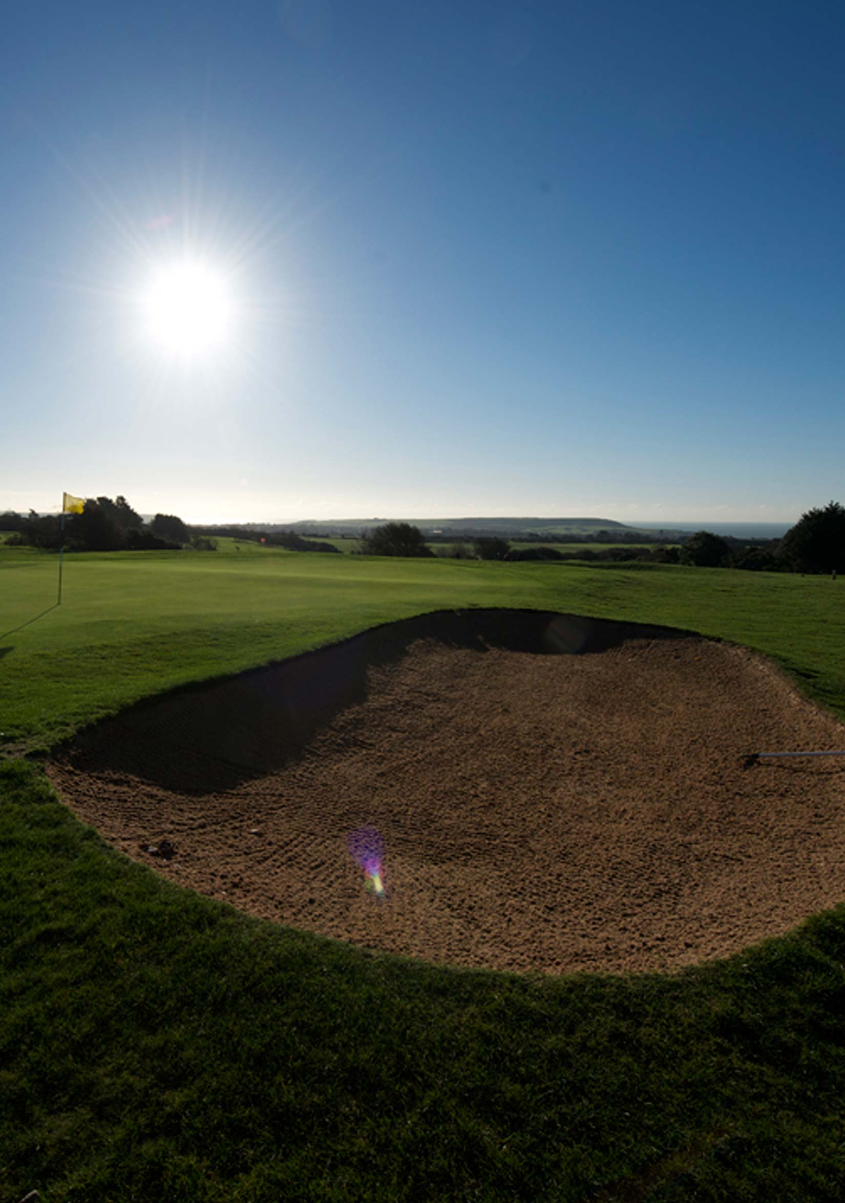 Ripon Golf Course sand bunker under blue sky and sunshine