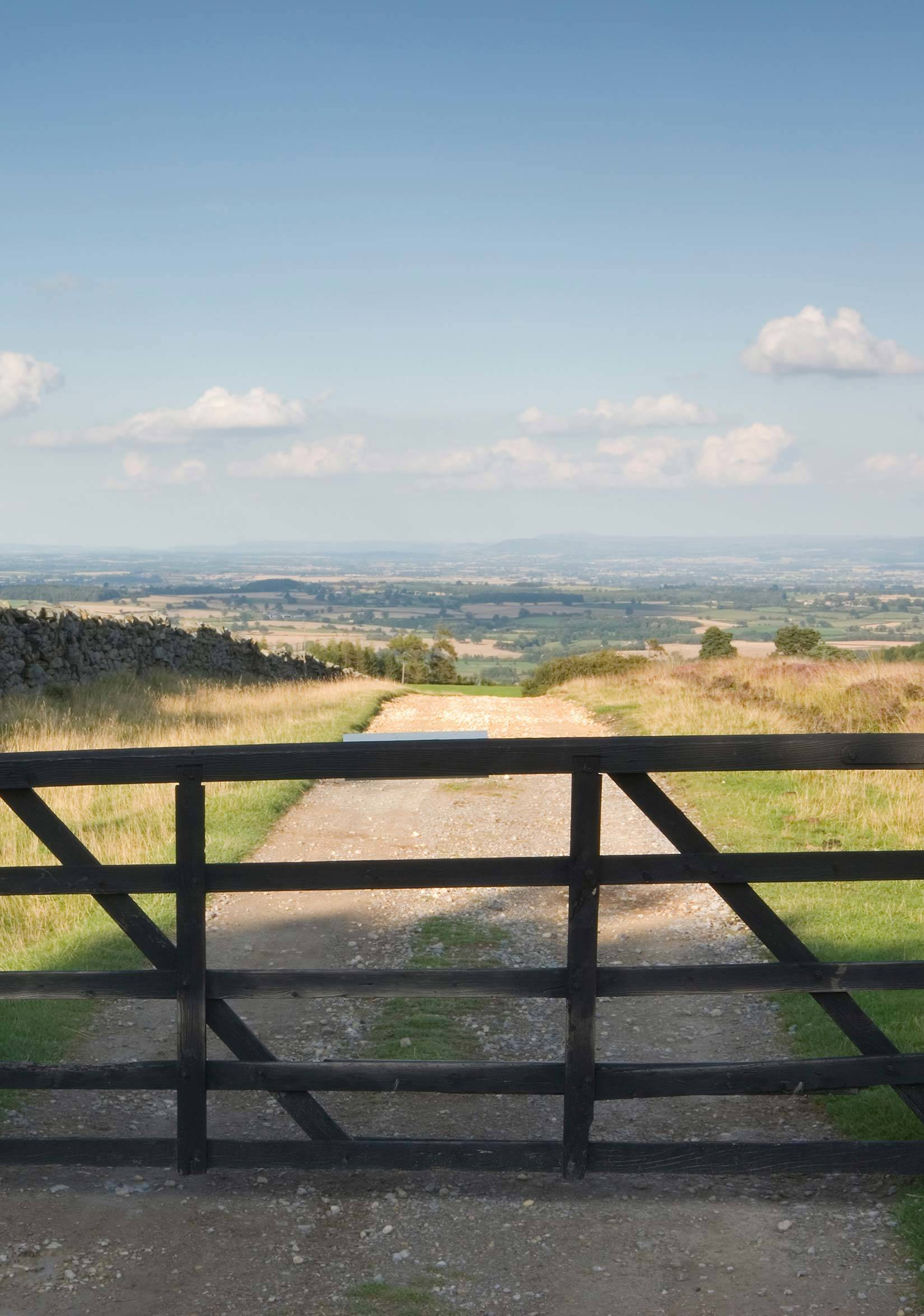Gate across an open track leading to wide view of the Yorkshire Dales