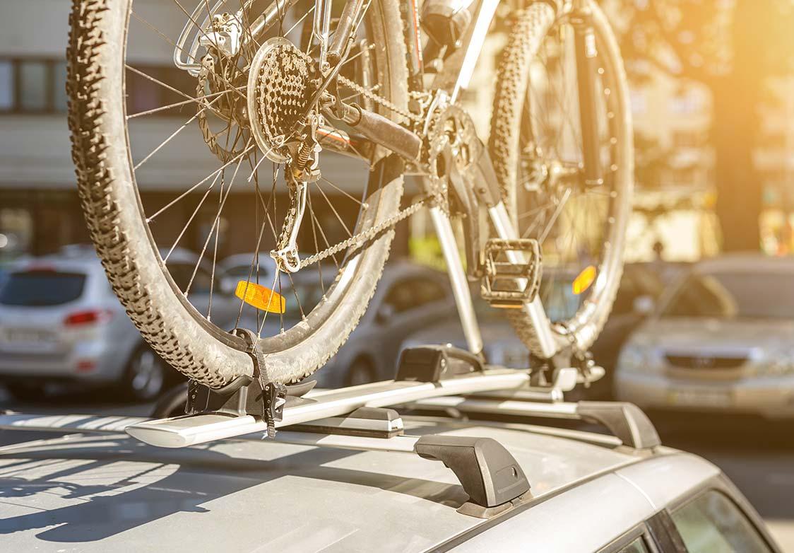 Bicycle on bike rack on roof of car