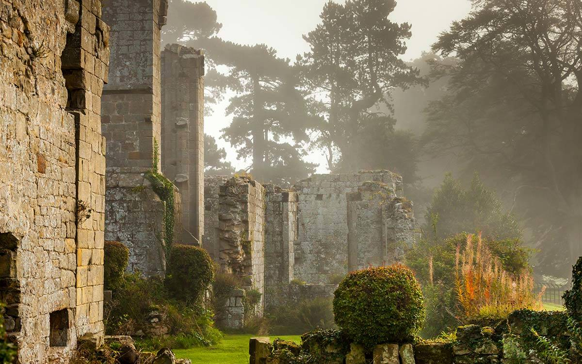 Jervaulx Abbey ruins in a misty atmosphere