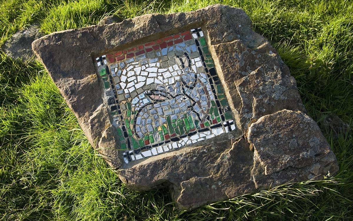 Mosiac rabbits on a stone on the mosaic walk near Morton House in Masham