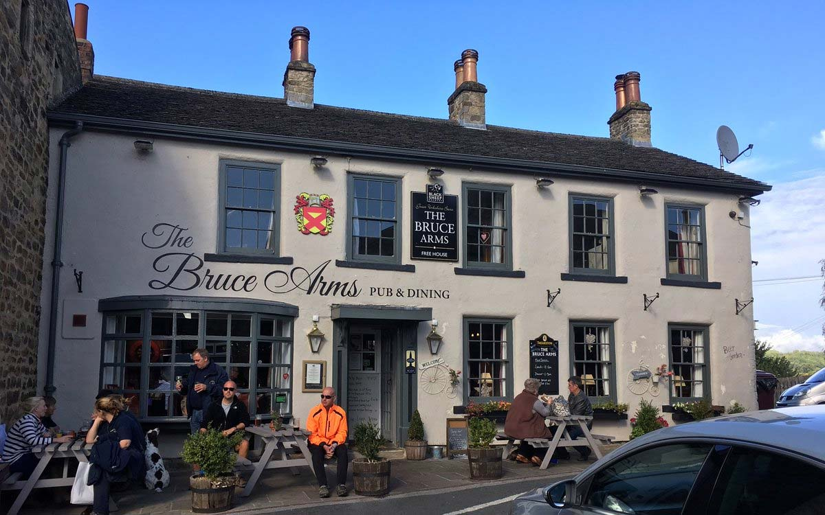 Front facade of The Bruce Arms on the little market place square near Morton House in Masham