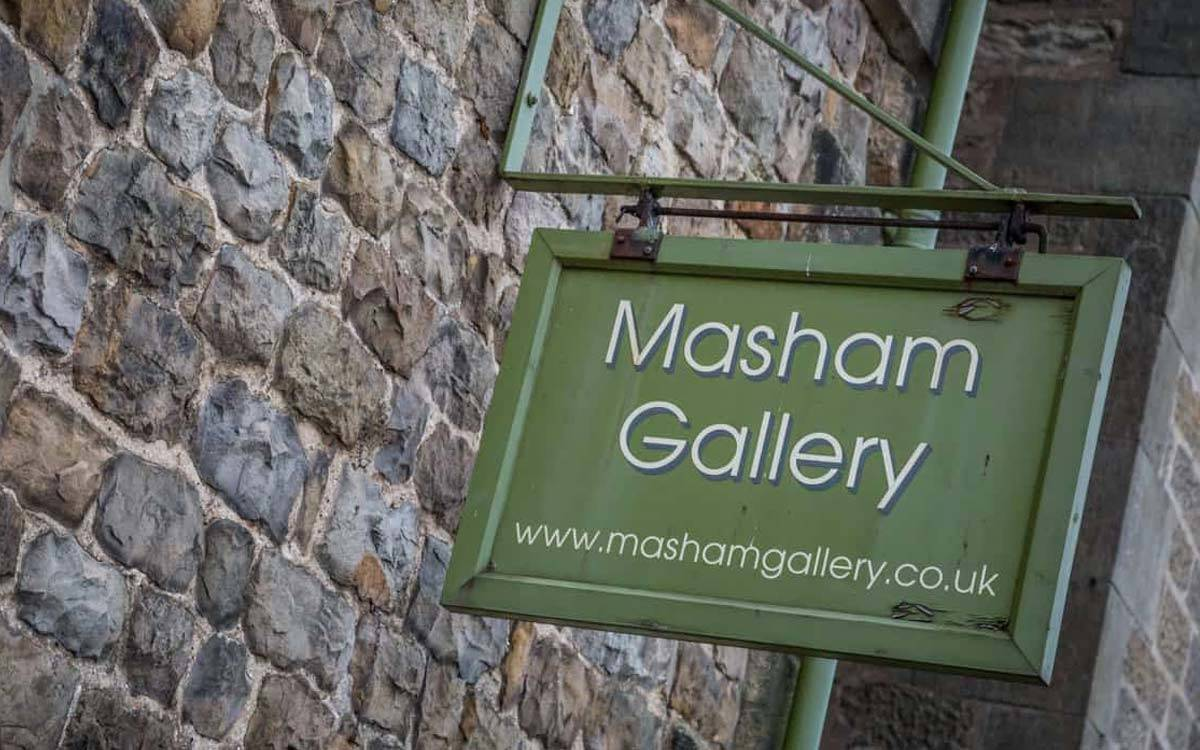 Masham Gallery sign on the Market square near Morton House in Masham