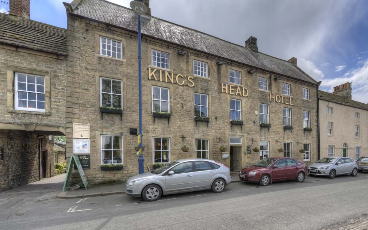 Front facade of The Kings Head Hotel on the market place square near Morton House in Masham