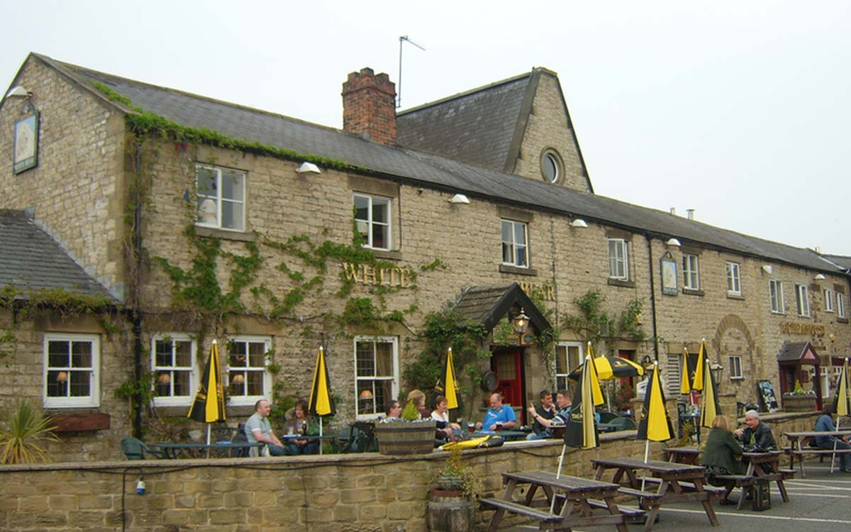 People sitting on the terrace at the White Bear Hotel near Morton House in Masham