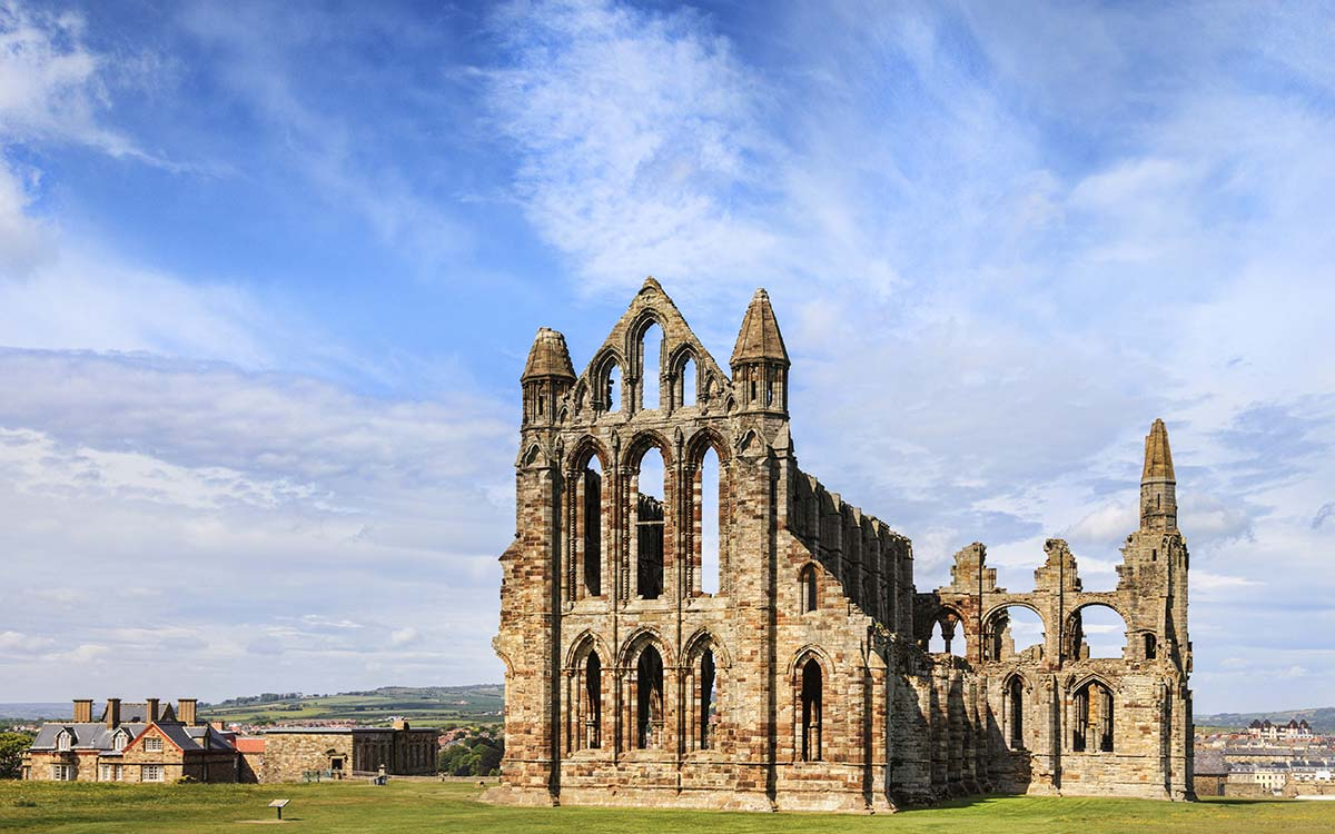 Whitby Abbey ruin in Yorkshire on a sunny day with blue sky