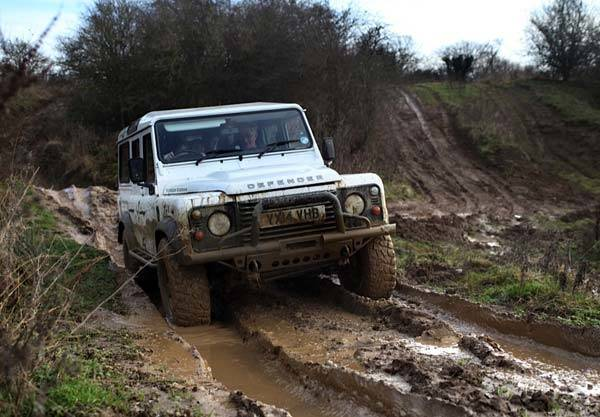 Yorkshire 4 x 4 defender driving though the mud