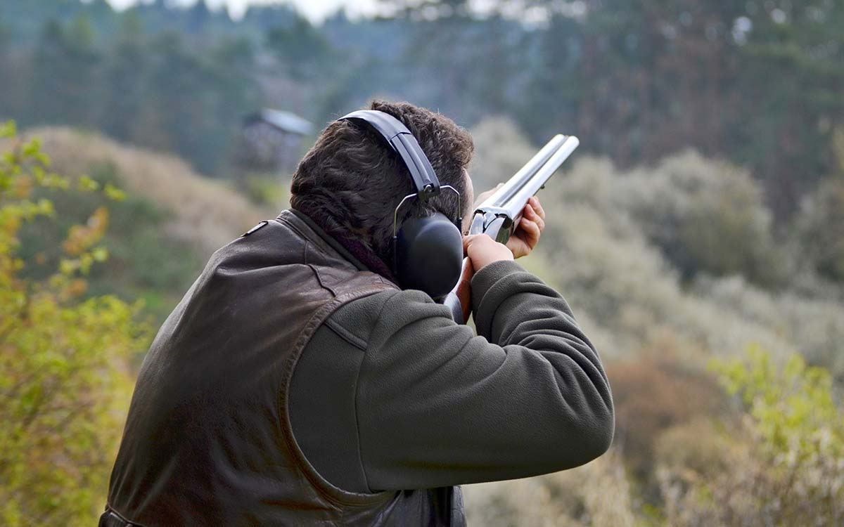 Man with rifle clay shooting near Masham