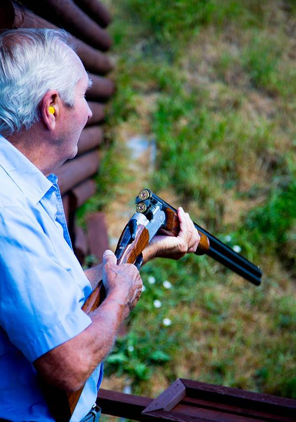 Man with rifle cocked ready to commence clay shoot