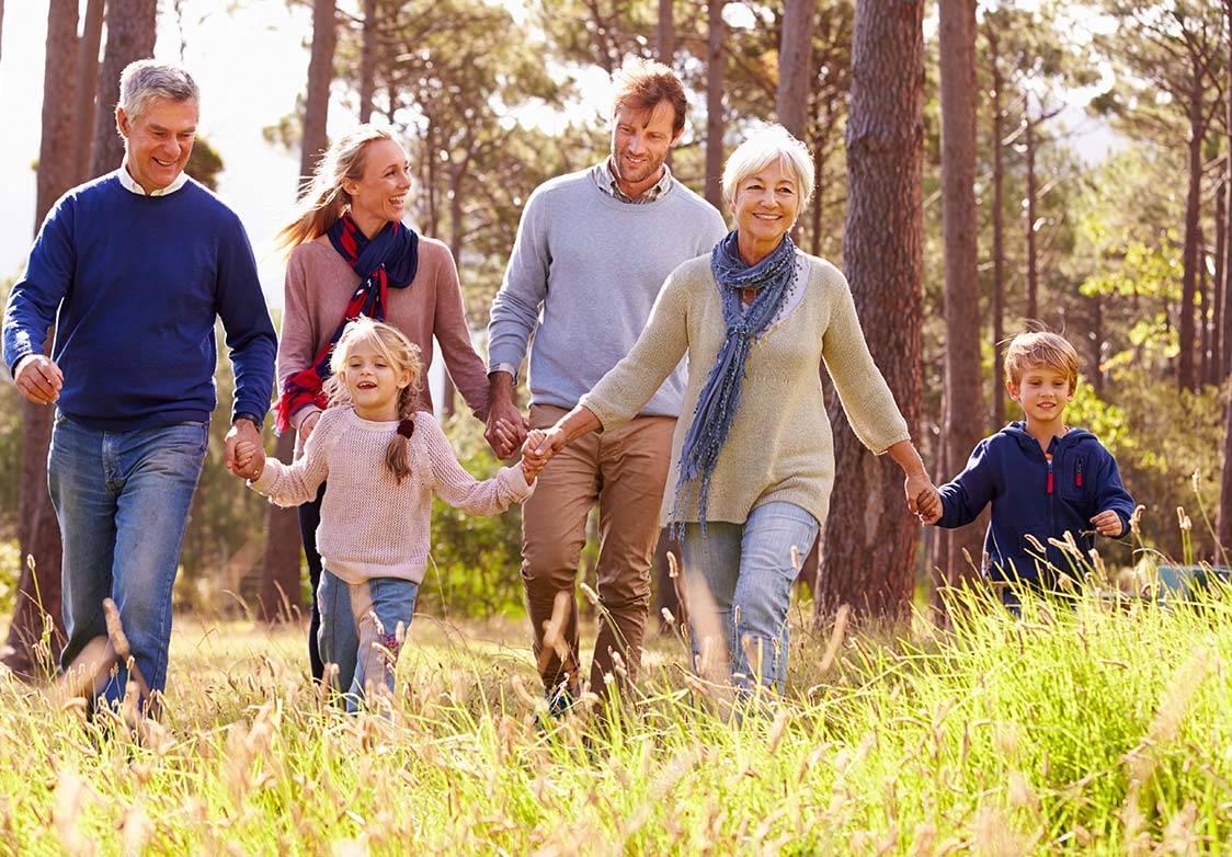 Extended family walking through woods near Morton House in Masham