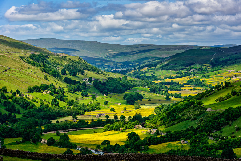 Aerial wide view of Yorkshire-Dales-National-Park with fluffy clouds in the sky