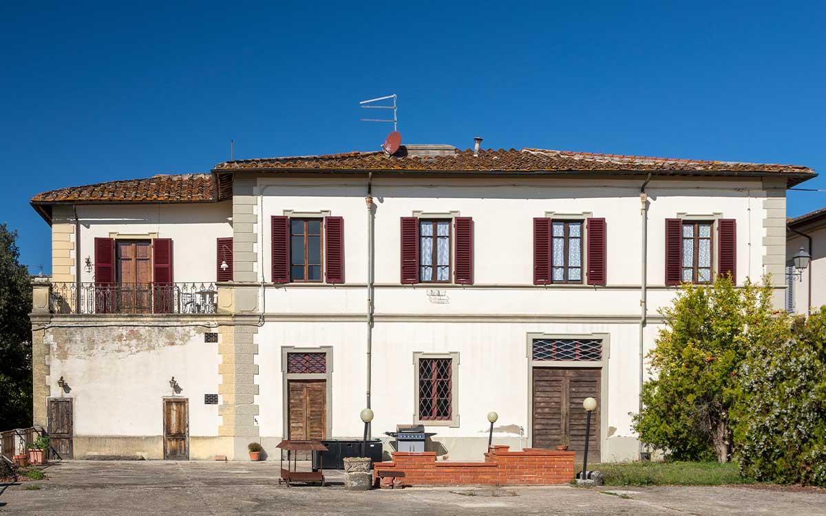 Villa Cicogna external front facade with shutters open